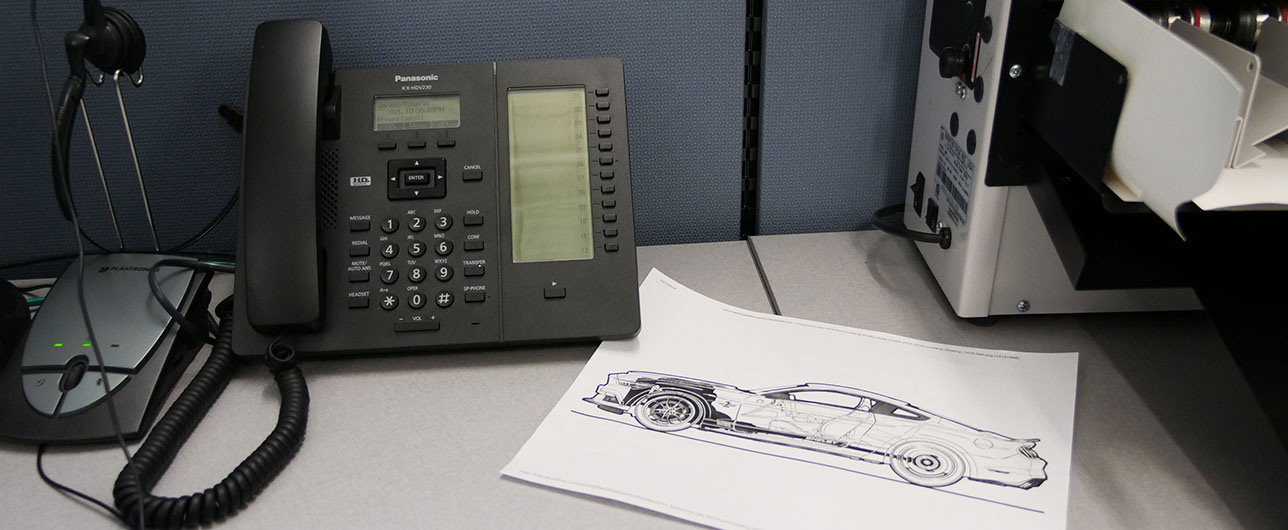 Panasonic phone next to a Shelby concept drawing