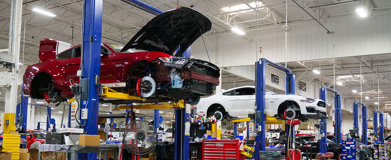 Shelby cars on lifts while in the production queue