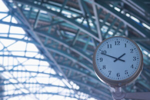 Clock hanging in modern railway station